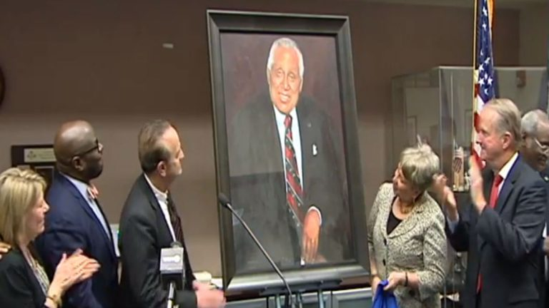 The late James Gilliam's portrait is unveiled at the New Castle County Community Service Building that bears his name. (Charlie O'Neill/WHYY)