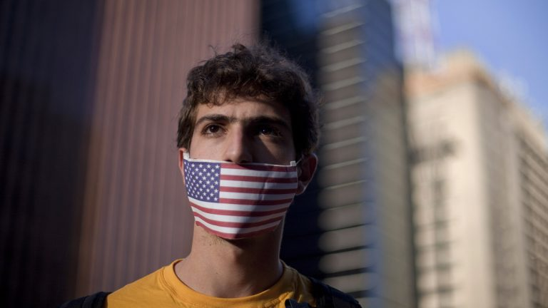 A protester in Sao Paulo, Brazil, is shown protesting in July 2013 against their government's rejection of the asylum application of Edward Snowden, who leaked top-secret documents about sweeping U.S. surveillance programs. (AP Photo/Andre Penner, file)