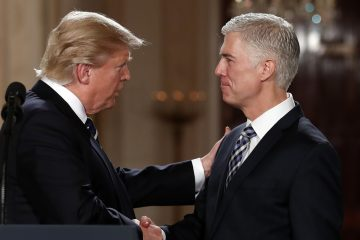 President Donald Trump watches as Supreme Court Justice Anthony Kennedy administers the judicial oath to Judge Neil Gorsuch during a re-enactment in the Rose Garden of the White House White House in Washington, Monday, April 10, 2017. (AP Photo/Evan Vucci)