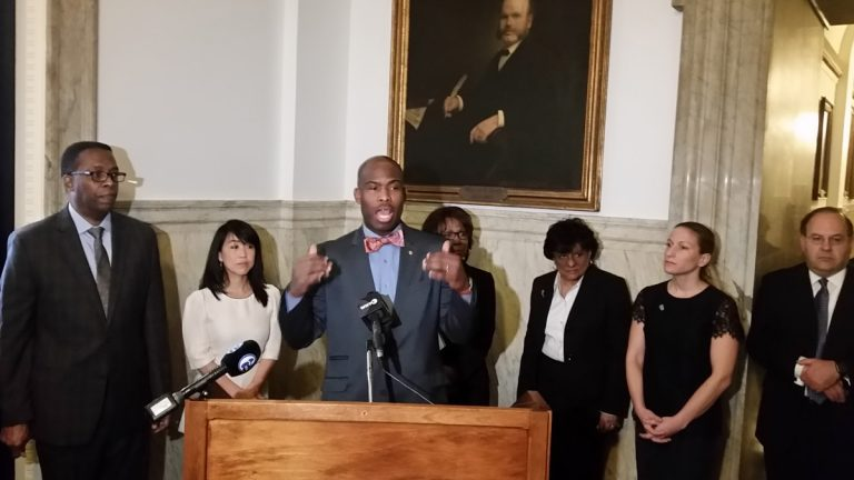 Councilman Derek Green discusses his idea to add solar panels to Philadelphia's public schools. (Tom MacDonald/WHYY)
