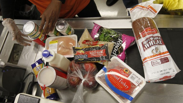 A cashier scans purchases at a ShopRite grocery story in Philadelphia. (AP Photo/Matt Rourke, file)