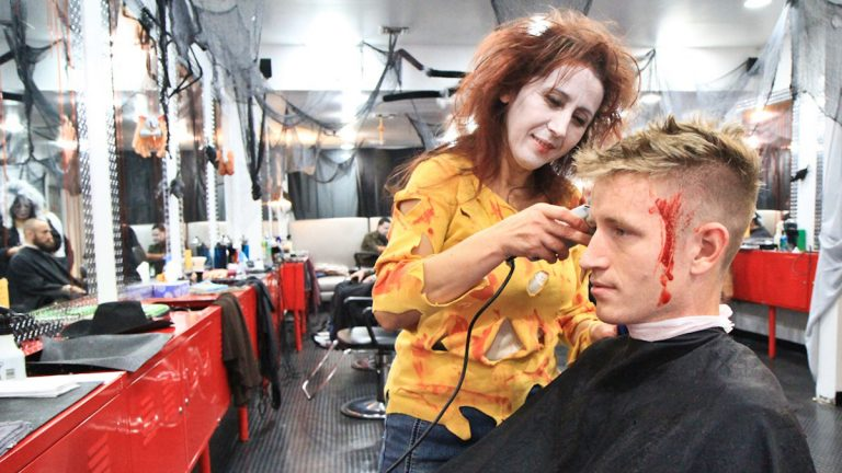Hair stylist Ruki took more than Kevin Breen bargained for at the Chop Shop's Halloween event to benefit UNICEF. (Kimberly Paynter/WHYY)