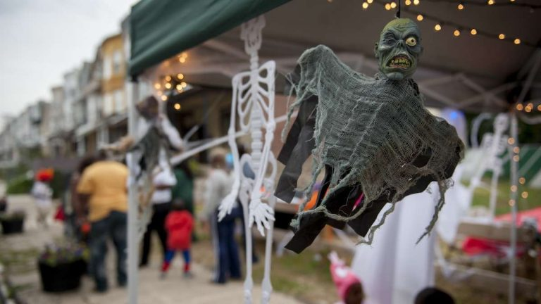 A ghastly ghoul hangs at the Halloween festivities organized for West Rockland Street in Germantown by Emaleigh and Aine Doley on Halloween evening. (Tracie Van Auken/for NewsWorks)