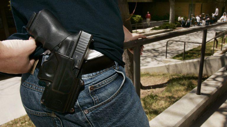 A man displays his handgun. (AP Photo/Douglas C. Pizac, file)