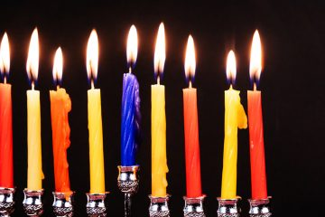 (<a href='http://www.bigstockphoto.com/image-148779242/stock-photo-the-lit-of-hanukkah-candles'>ungvar</a>/Big Stock Photo)