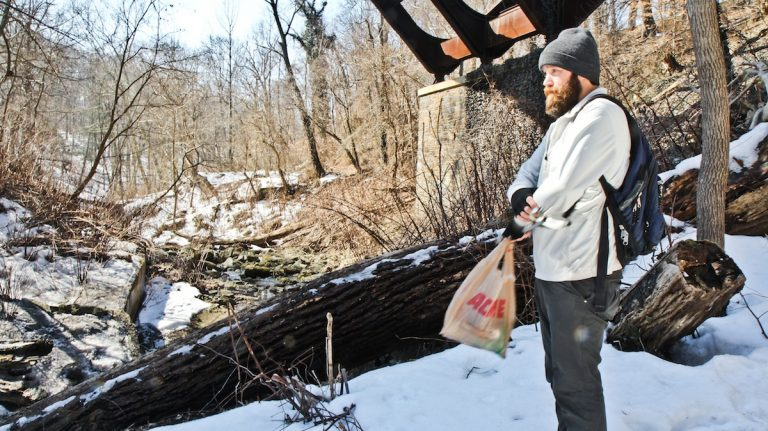 Since January, Bradley Maule has been hunting down trash in a 1,400-acre parcel of Fairmount Park as part of his yearlong 'One Man's Trash' effort. (Kimberly Paynter/WHYY)