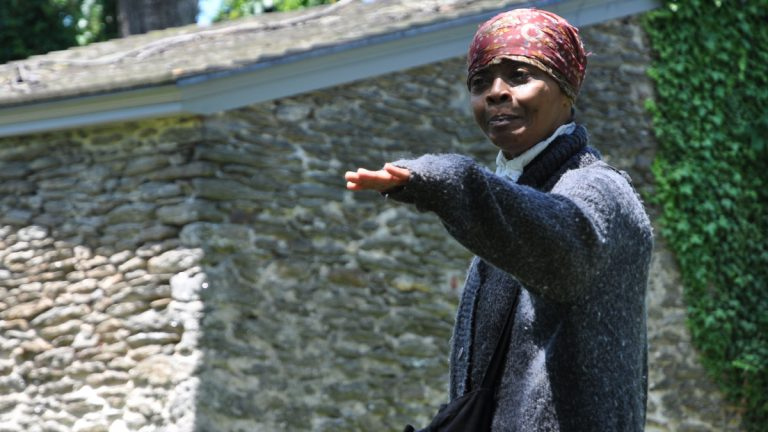 Actress Millicent Sparks performs a monologue as Harriet Tubman at the Johnson House historic site in Germantown for the 2011 Juneteenth National Freedom Day Festival. (Yara Simón for NewsWorks