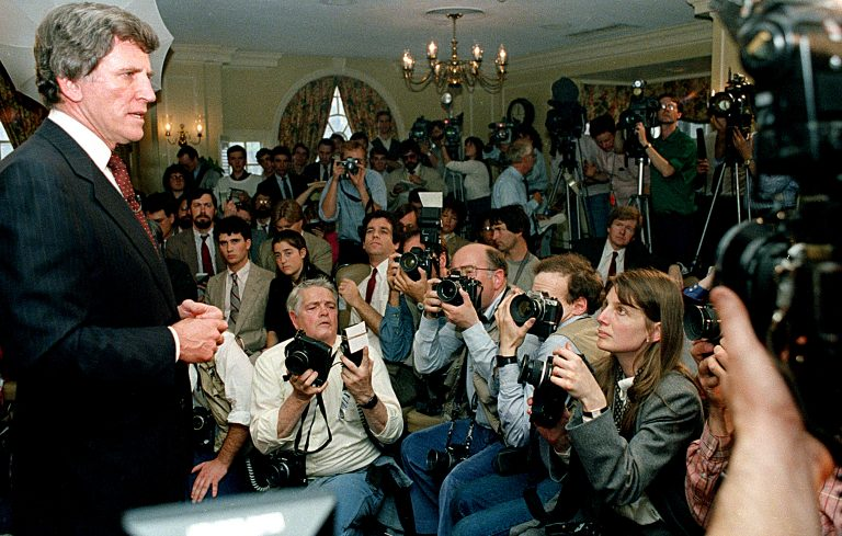 Presidential candidate Gary Hart faces questions about his relationship with Donna Rice in 1987. (AP photo/Jim Cole)