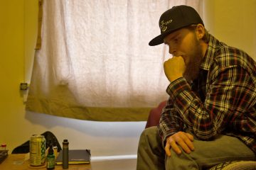 Zach Hassinger in his apartment in downtown Lewisburg, which he got through the Union County Justice Bridge Housing Program aimed at preventing people on probation or parole from re-offending. Hassinger, 23, has been sober since being charged two years ago with felony drug-dealing and other offenses. (Lindsay Lazarski/WHYY)