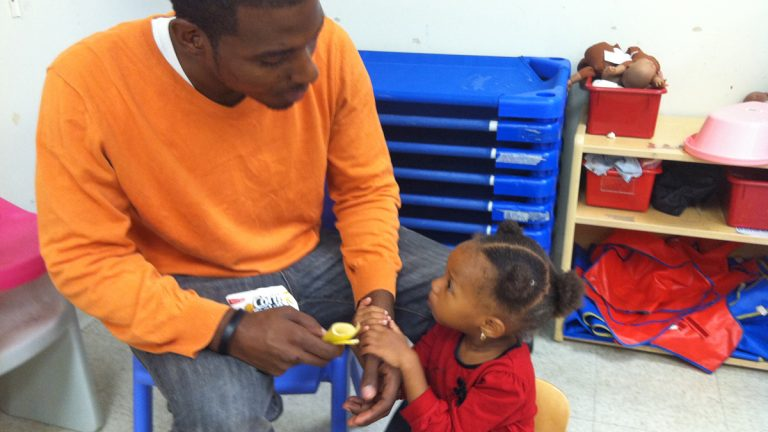 Marcus Tuggles with daughter Kailani, 2, sees cuts to Head Start programs as tragic.  (Elana Gordon/WHYY)