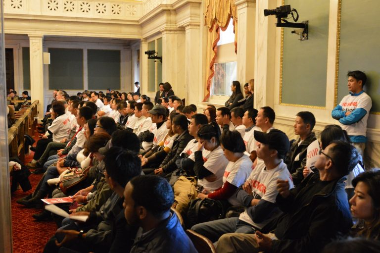 Members of Philadelphia's Asian community attended a hearing on home invasion robberies. (Tom MacDonald/WHYY)