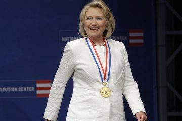 Former Secretary of State Hillary Rodham Clinton is shown on stage after receiving the Liberty Medal during a ceremony at the National Constitution Center, Tuesday, Sept. 10, 2013, in Philadelphia. (AP Photo/Matt Rourke, file)
