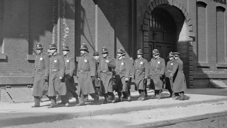 Large cities began offering pensions to police officers and firefighters in the 1800s. In the photograph, police patrol marching outside Baldwin Locomotive Works in Philadelphia, Pa. circa 1910. (Image courtesy of the Library of Congress)