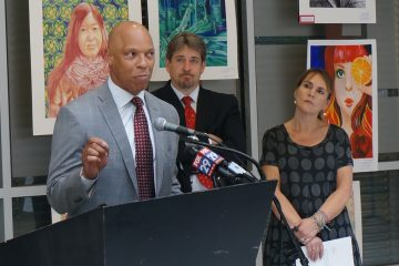 From left, Philadelphia  Schools Superintendent William Hite; David Rubin, the founding co-director of PolicyLab at The Children's Hospital of Philadelphia; and city Department of Human Services Commissioner Anne Marie Ambrose gather to announce a new report on the educational outcomes of public school students involved with DHS. (Jessica McDonald/WHYY)