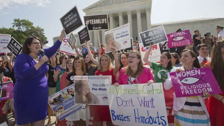 Kristin Hughs, left, is shown announcing to supporters the Supreme Court's decision on the Hobby Lobby case in Washington, on Monday, June 30, 2014. (AP Photo/Pablo Martinez Monsivais)