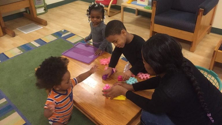 Sasha and her children, 4-year-old Lamere, 2-yera-old Serenity, and 1-year-old Sincere, play at a homeless shelter. (Zoe Read/WHYY)