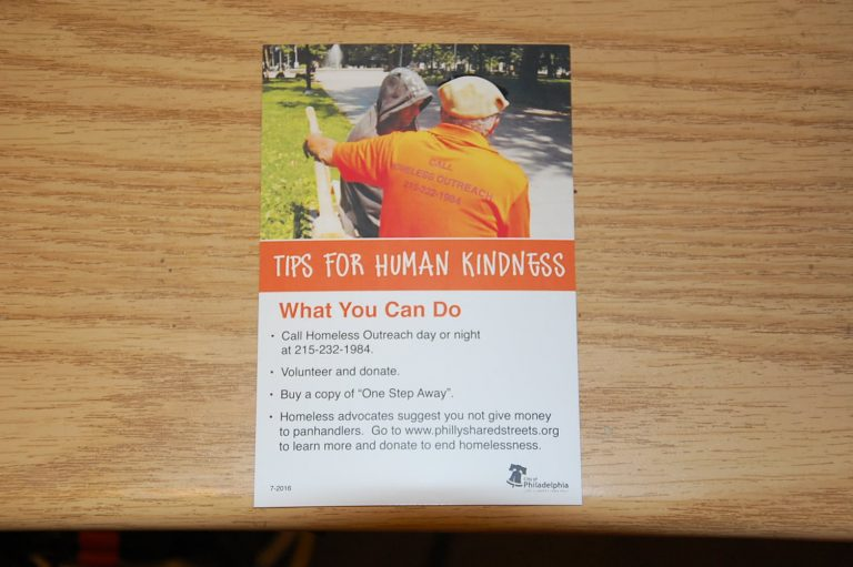 The city will hand out cards with alternatives for helping homeless. (Tom MacDonald/WHYY)