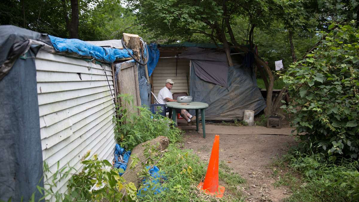 Dave Ritchie, a plumber by trade, lives in a nearby self-made shack in the woods in Allentown, Pa. (Lindsay Lazarski/WHYY)