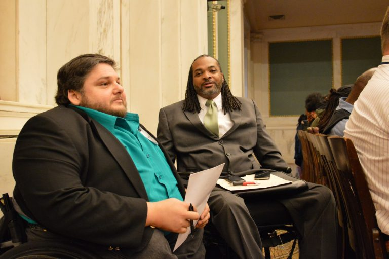 Charles Horton and Matt Clark talk during City Council hearing on funding for the city's commission on disabilities.  (Tom MacDonald