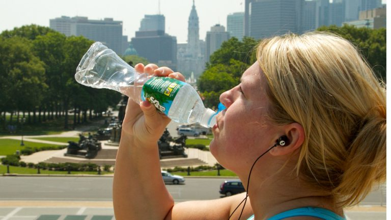 Leigh Binnion, visiting from Houston, enjoys some cool water. (Nat Hamlilton/for NewsWorks, file photo)