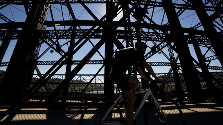 A bicyclist crosses the Hot Metal Bridge on a late fall day.  (Ryan Loew for 90.5 WESA)