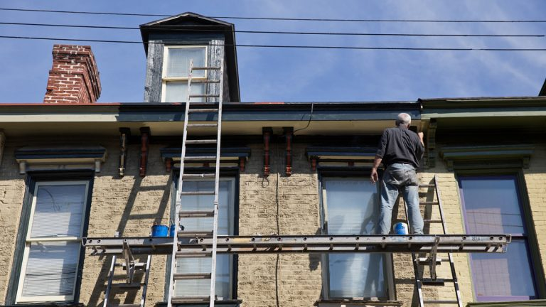 David McCloud restores an aging home in the Mexican War Streets district of Pittsburgh, Pa. New research by the Federal Reserve's Philadelphia office shows a vast majority of lower-income households in Pennsylvania spend more than the conventionally-advised one third of income on housing. (Lindsay Lazarski/WHYY)