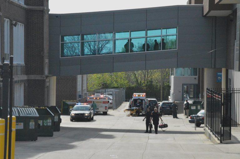 Paramedics walk outside Howard High School April 21st. (John Jankowski/for NewsWorks)
