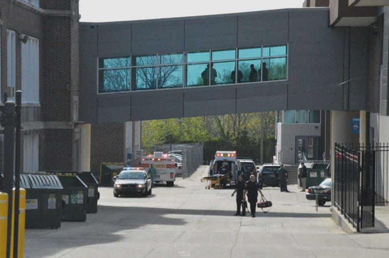 Paramedics walk outside Howard High in Wilmington Thursday morning. (John Jankowski/for NewsWorks)