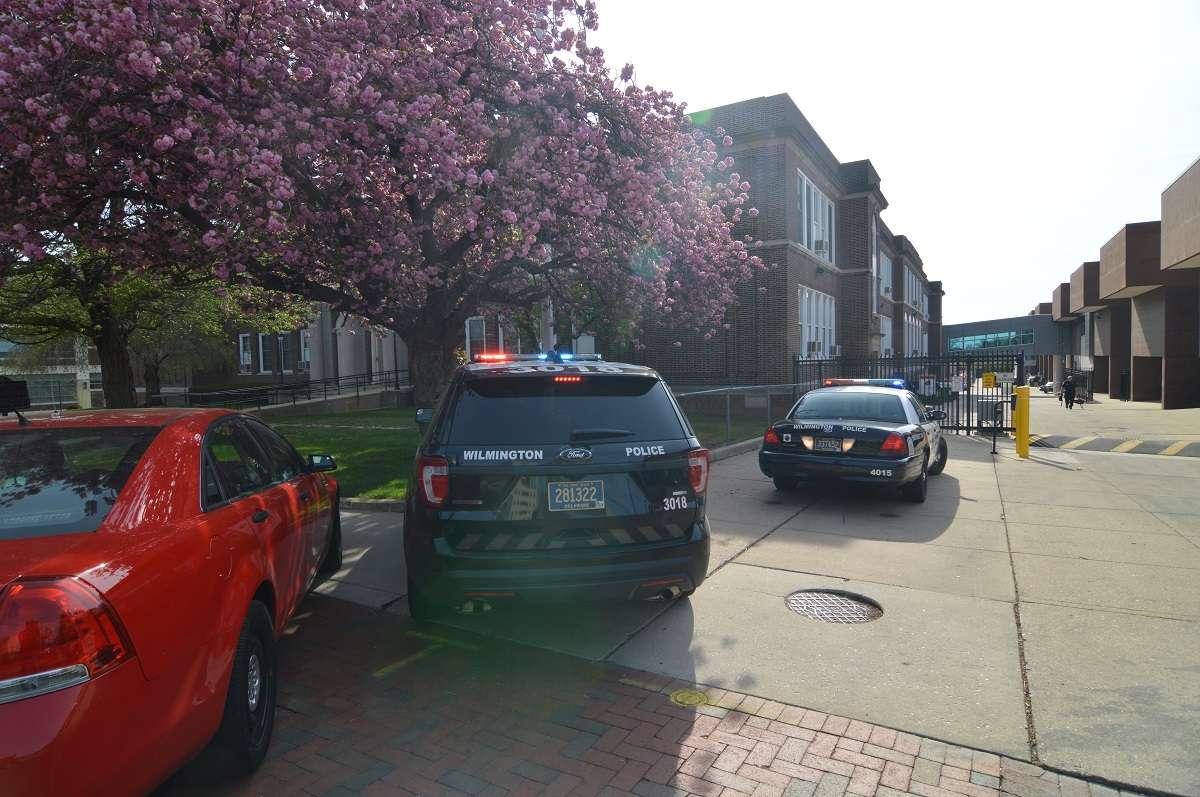 Police vehicles outside Howard High in Wilmington. (John Jankowski/for NewsWorks)