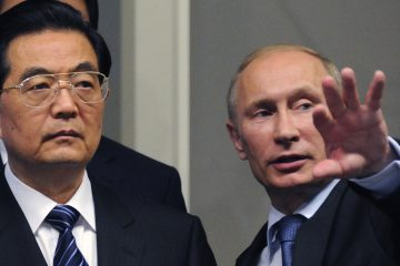 Russian Prime Minister Vladimir Putin, left, is shown with Chinese President Hu Jintao in 2011. (AP Photo/Alexander Nemenov, file)