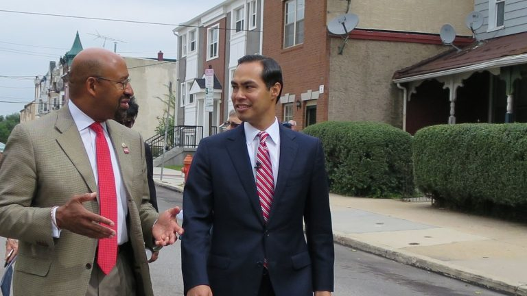 Mayor Michael Nutter and HUD Secretary Julian Castro tour the Mantua neighborhood of West Philadelphia. (Marielle Segarra/WHYY)