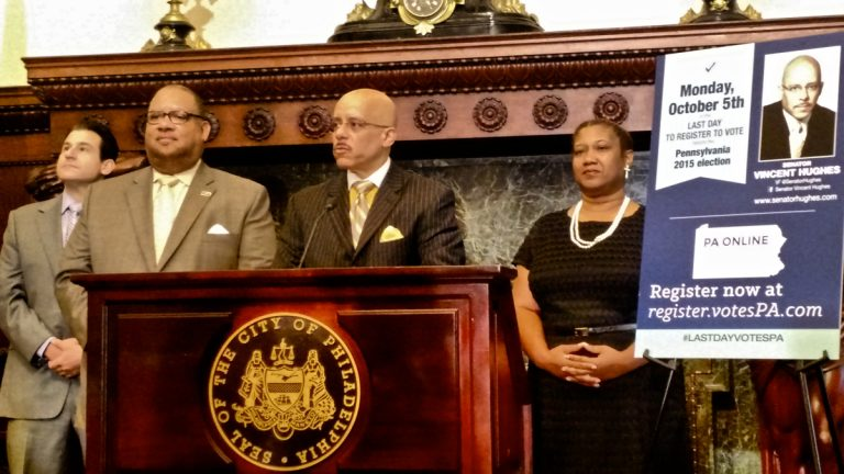 State Sen. Vincent Hughes urges Pennsylvania voters to register online during a press conference at City Hall. (Katie Colaneri/WHYY)