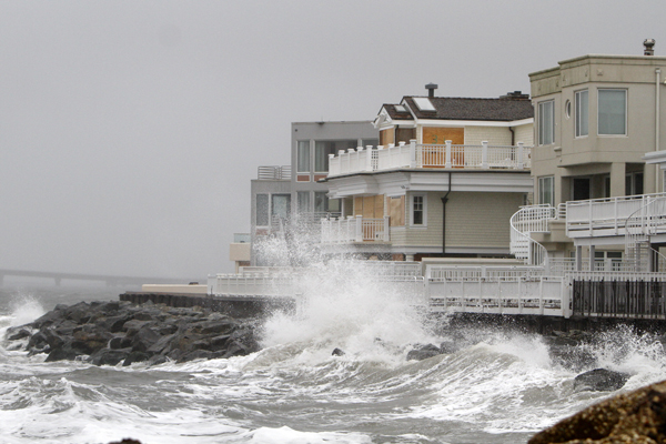 Waves crash onto the sea wall protecting homes in Longport, N.J., Sunday, Oct. 28, 2012, as Hurricane Sandy approaches the area. (AP Photo/Joseph Kaczmarek)