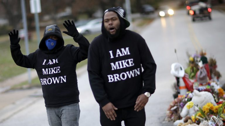 Protesters gather near a memorial in the middle of the street in Ferguson, Missouri, on Nov. 24, 2014, more than three months after a white policeman shot and killed Michael Brown, a black 18-year-old man, there. A grand jury later that night released its decision not to indict the the police officer. (AP Photo/David Goldman)