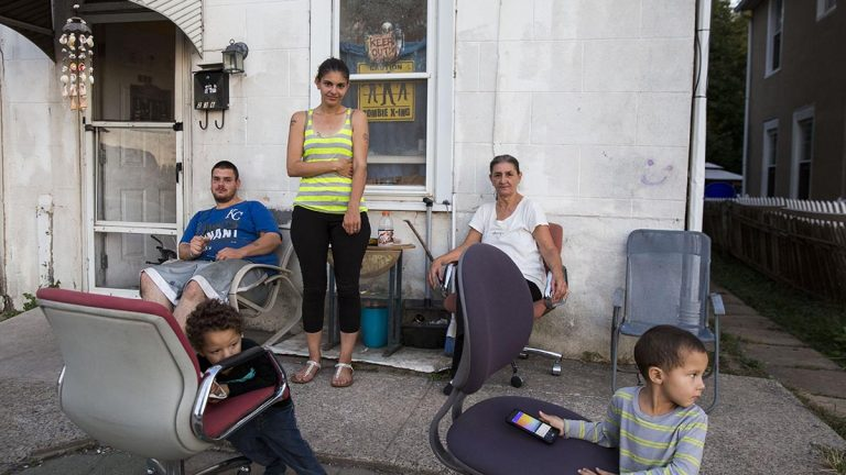 "From left to right: Anthony Petraline, 22, Crystel Petraline, 27, Mary Petraline,52, with Mason, 4, and Liam, 3, in front of their home near one of the boundaries for the 7th and the 13th districts in Norristown, Pennsylvania. Crystel and Mary said they plan on voting for Hillary Clinton. ""Her being about children will definitely benefit us,"" said Crystel. (Lindsay Lazarski/WHYY)"