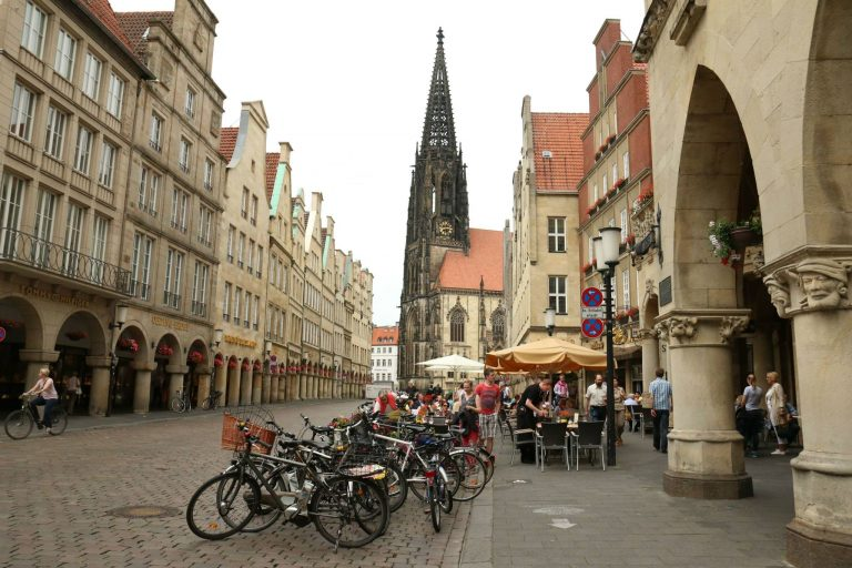 Bikes parked in front of Lambertikirche (St. Lambert's Church)in—  Münster.. (Marielle Segarra/WHYY)