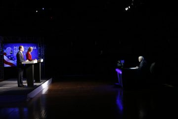 Pennsylvania U.S. Senate candidates Republican Sen. Pat Toomey, left, and Democrat Katie McGinty take part in a debate moderated by Action News anchor Jim Gardner, right, at Temple University in Philadelphia, Monday, Oct. 24, 2016. (AP Photo/Matt Rourke)