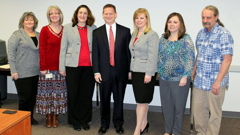 Attorney General Matt Denn (center) poses with members of the IEP Improvement Task Force (Photo courtesy of the Delaware Department of Justice).