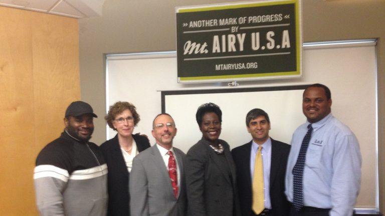 (L to R) Jimmie Reed of Little Jimmie's Bakery and Cafe; Lisa Worden of the Department of Community and Economic Development; David Hyman of Kleinbard Bell & Brecker LLP; State Rep. Cherelle Parker; Anuj Gupta of Mt. Airy USA and Department of Licenses and Inspections Commissioner Carlton Williams (Neema Roshania/WHYY)