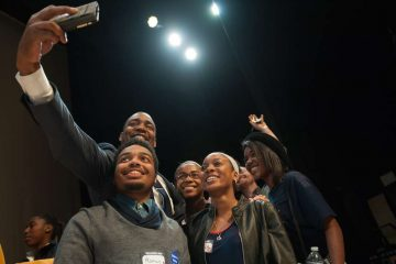 Mayoral candidate Doug Oliver poses for a selfie with students who attended the Youth Mayoral Summit at Venice Island Perfoming Arts Center in Manayunk Saturday afternoon. (Tracie Van Auken/for NewsWorks)