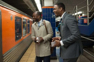 Doug Oliver and campaign spokesman Mustafa Rashed interact with voters on the Broad Street Line. (Tracie Van Auken/for NewsWorks)