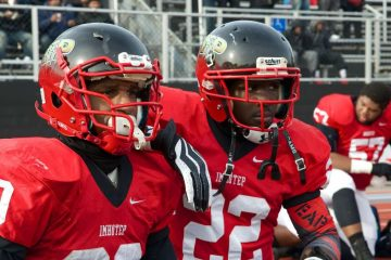 Imhotep Panthers running backs Nasir Bonner and Mike Waters prepare to take the field for Saturday's state-quarterfinal playoff game. (Bas Slabbers/for NewsWorks)