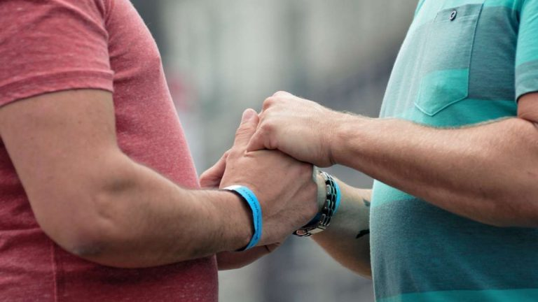 Biff Viner and Thomas Krik of Philadelphia hold hands as they say their vows. (Bas Slabbers/for NewsWorks)