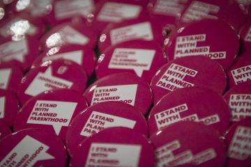 Pins on display at Philadelphia Episcopal Cathedral at a Planned Parenthood event. (Branden Eastwood for WHYY)