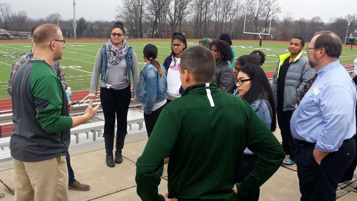 A. J. Maida leads students from Kensington Health Sciences Academy on a tour of the Methacton High School athletic facilities.