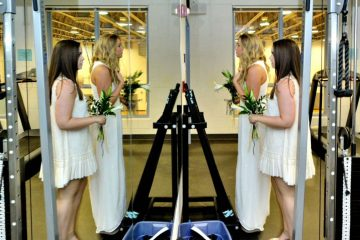A pair of soon-to-be graduates from Springside Chestnut Hill Academy take one last look before their graduation ceremony began on Wednesday. (Bas Slabbers/for NewsWorks)
