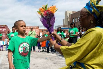 Though Imani Charter School faces the threat of closure, students and staff still celebrated 'Spirit Day' to honor the school's founder, Dr. Francine Fulton, in May. (Bas Slabbers/for NewsWorks)