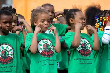 They were smiling at Imani Education Circle Charter School in May, but they still don't know whether the school will open in September. (Bas Slabbers/for NewsWorks)
