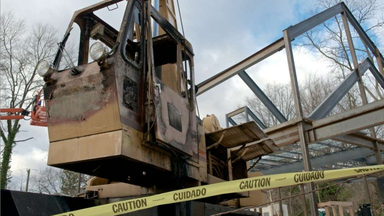 Signs of vandalism and arson were evident at the Chestnut Hill Meeting House site after the Dec. 2012 incident. The operating cabin of a construction crane was rendered useless by fire. (Bas Slabbers/for NewsWorks)