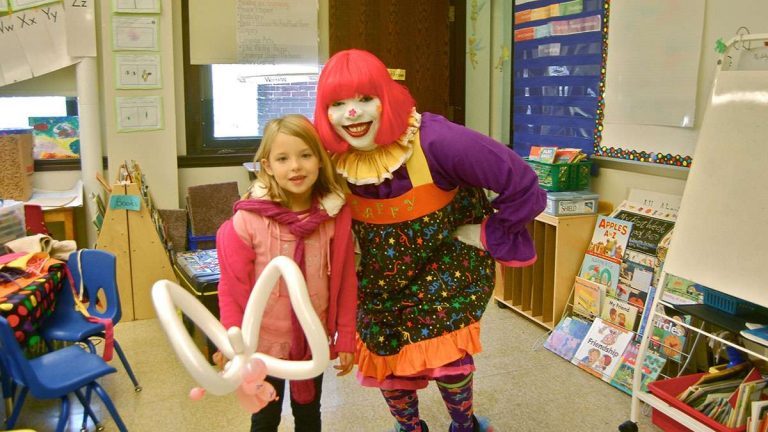 Helena doesn't attend Thomas Mifflin School, but she attended last year's Community Day and got a balloon from 'Taffy the Clown.' (NewsWorks file art)